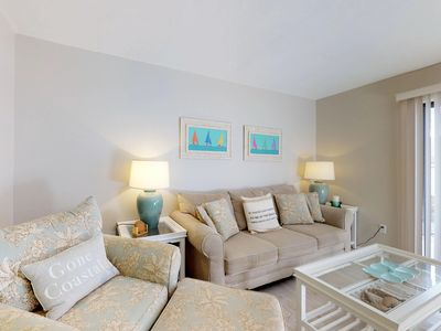 Photo for Elegant beach condo with a community heated pool and great location!