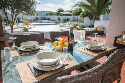 Al Fresco dining area with view of pool,garden and large terrace area