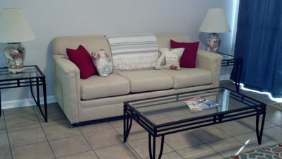 Living room with new queen, sleeper sofa.