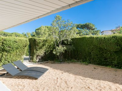 Photo for 3 bedroom ground floor apartment with terrace, garden, shared pool and walking distance to the beach (H54)