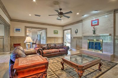 This expansive 6,000-square-foot home sleeps 14 with room for 2 more!