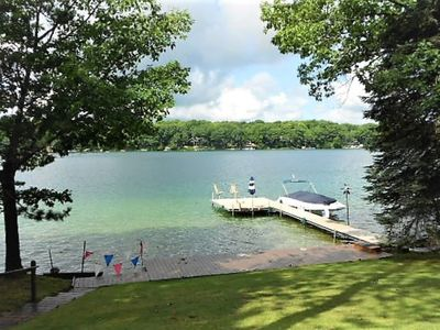 Photo for Pristine waterfront vacation home on Desirable All-Sports Big Twin Lake.