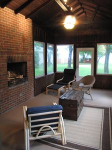 Awesome screened in porch with wood burning fireplace.