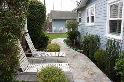 Side yard with lounge chairs