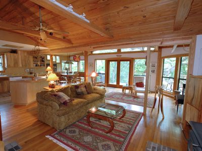 Photo for Relax in a craftsman home nestled in the forest minutes from the city