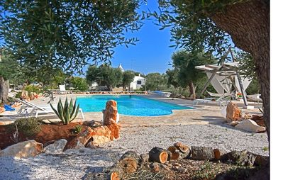 Photo for Magnificent Trulli with salt water pool set in ancient Olive groves