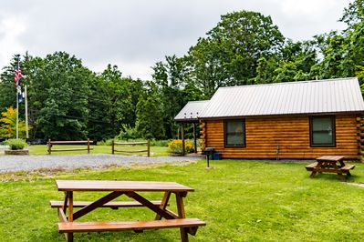 Picnic tables and BBQ grill outside cabin B