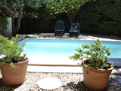 Photo for Guest room with garden access and communal pool