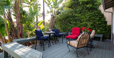 The front deck-perfect for lounging-surrounded by benches for afternoon parties!