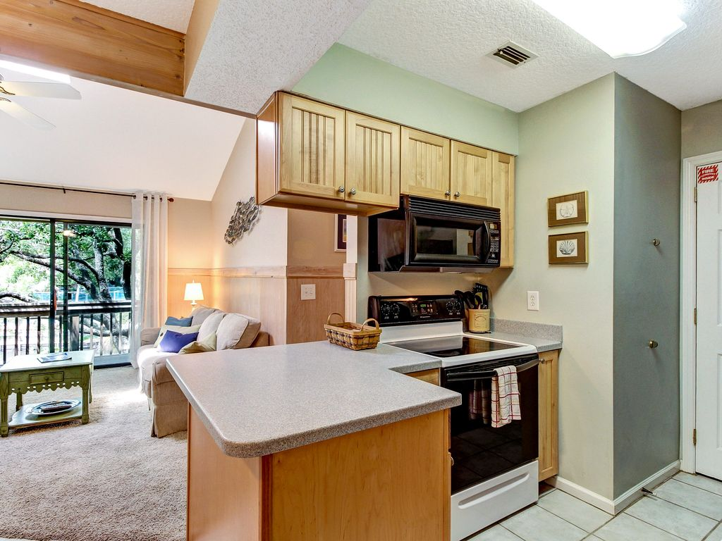cheerful condo with swimming pool tennis courts playground grills