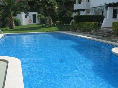 Photo for Apartment to Rent on the first floor in a complex situated about 1.5 km away from the beach of Pals. Community area with gardens and swimming pool.