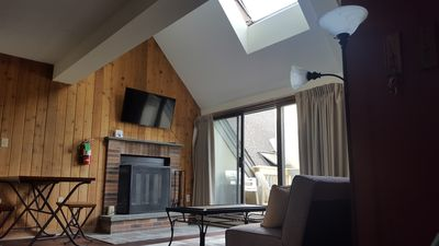 Welcome to your Condo, 14ft vaulted ceiling, private balcony, walk to the lift