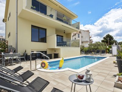 Photo for Modern apartment with seaview, private terrace and pool,only 150m from the beach