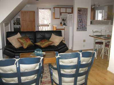 Photo for Spacious and sunny: private deck overlooking flowering garden. Beach 300 ft.