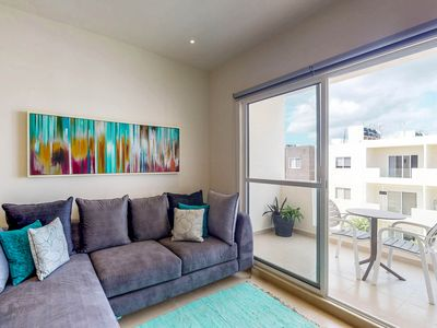 Photo for NEW LISTING! Quiet, luxury condo near downtown - shared pools & private balcony
