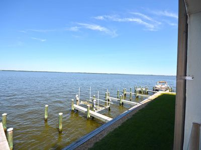 Photo for Cute, tropical condo with free WiFi, a boat dock, and a breathtaking view of the bay located uptown!