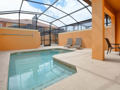 Photo for Pool/Free wifi/4 miles to disney/gated resort/communal pool and slides/tiki bar
