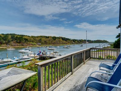 Photo for Breathtaking riverfront dog-friendly home w/ a lovely deck, close to the beach!