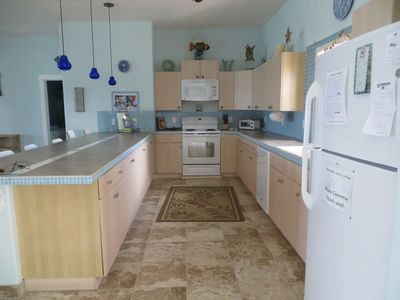 Spacious kitchen with all the gadgets you need to cook amazing meals or BBQ on the patio
