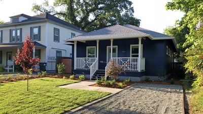 Brand new, fully-furnished comfortable home with front porch and 2-car driveway
