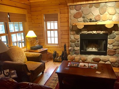 Great room with wood burning fireplace. Owners provide firewood at no additional cost.
