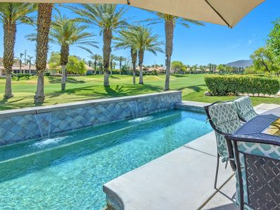 Beautiful back patio with private saltwater pool!Views are spectacular and patio with pool sits on the lush fairway of the course