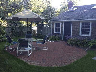 Private back yard with patio table  chairs and gas grill