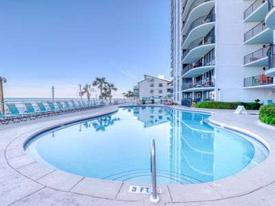 Photo for Private balcony w/ emerald ocean views - beach service available!