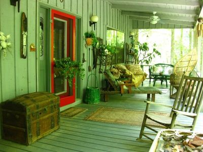 Covered Front Porch with Paddle Fans and a Cozy Atmosphere