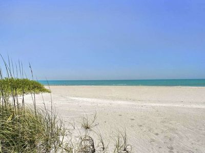 Photo for Spacious Club Longboat Key steps to the sand, private beach paradise! Pools, Gym, Tennis, Sunsets!