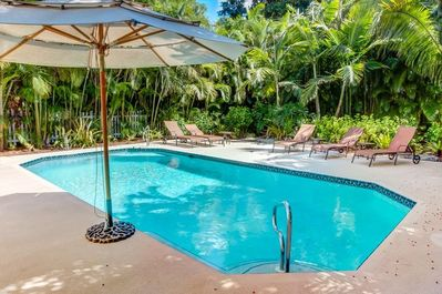 With a private heated pool surrounded by tropical landscaping and only 8 houses from the beach, this home is perfect for families!