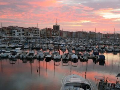 Photo for Nice apartment well located with superb views of the harbor. Private parking