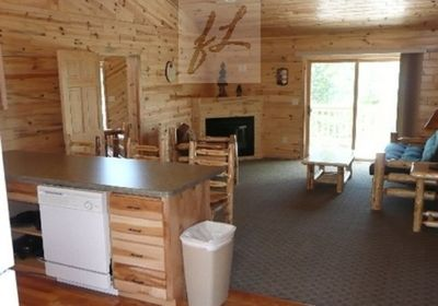 """Loon's Living Area with a Breakfast Bar and nice Living Area, has 48"""" TV"""