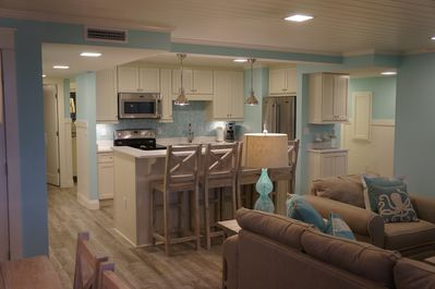 Great kitchen, dining & family space w/ wooden ceilings, light, bright & beachy!