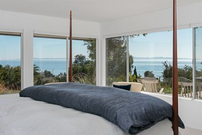 Master Bedroom - Welcome to your tropical oasis in Santa Barbara! Wake up to a gorgeous ocean view in the master bedroom.