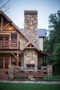 Outdoor Fireplace perfect for gathering family and friends, wrap around porch