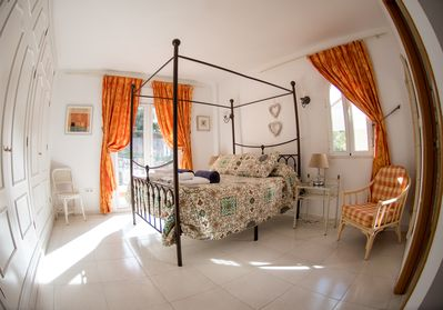 master bedroom with en-suite and balcony with bistro set