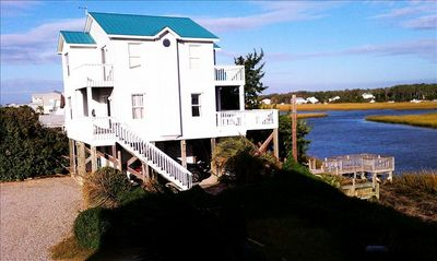 Photo for Two Seas- Beautiful Waterfront Beach House on Oak Island
