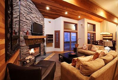"""Living room with wood burning fireplace, 42"""" plasma tv, dvd, and stereo."""