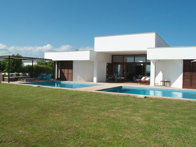 Photo for Contemporary luxury villa with sea view, large swimming pool, close to airport