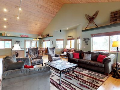 Photo for Wooded lodge w/ wrap-around deck - 1 block to the river, close to town/the lake!