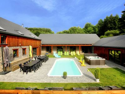 Photo for Beautiful villa with heated outdoor pool, sauna and jacuzzi at a large forest