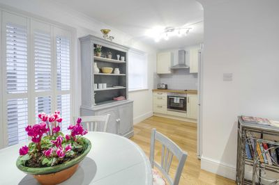 Dining area showing kitchen