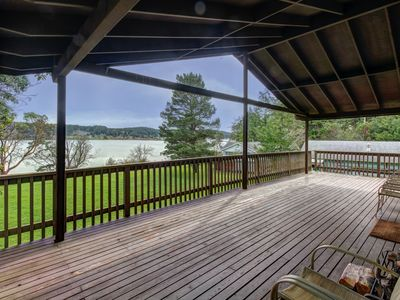 Photo for Tranquil bayfront home with a covered deck & large lawn, close to the beach!