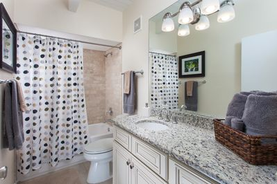 2nd Bathroom off Entry with Custom Cabinets & Granite Countertop