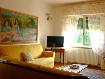 Photo for Bright ground floor in a villa with lake front garden, light blue beach.