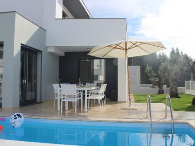 Photo for Modern villa with private pool at a few steps from the beach