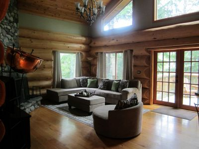 Large expansive windows in the living area that leads onto the back deck