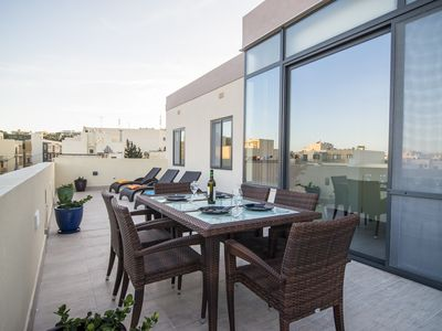 Photo for Romantic penthouse with views.