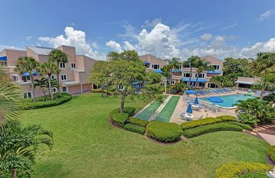 Photo for 314 Sand Cay Beach Resort Pool & Garden VIew